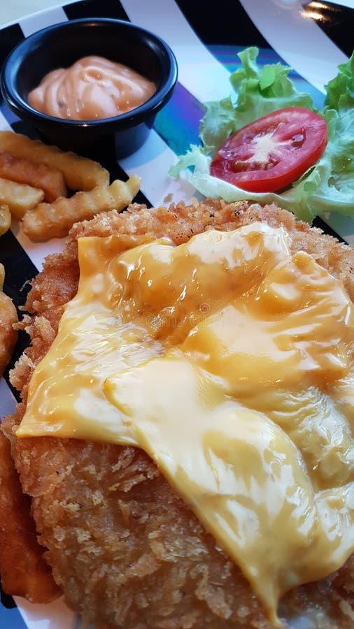 Χρυσό τυρί κοτόπουλου στοκ φωτογραφία με δικαίωμα ελεύθερης χρήσης