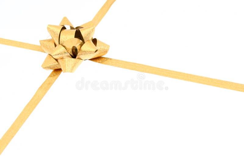 Χρυσό τόξο δώρων στοκ εικόνα με δικαίωμα ελεύθερης χρήσης