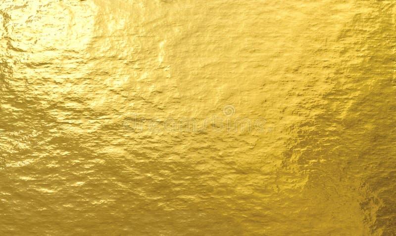 Χρυσό υπόβαθρο σύστασης φύλλων αλουμινίου στοκ φωτογραφία