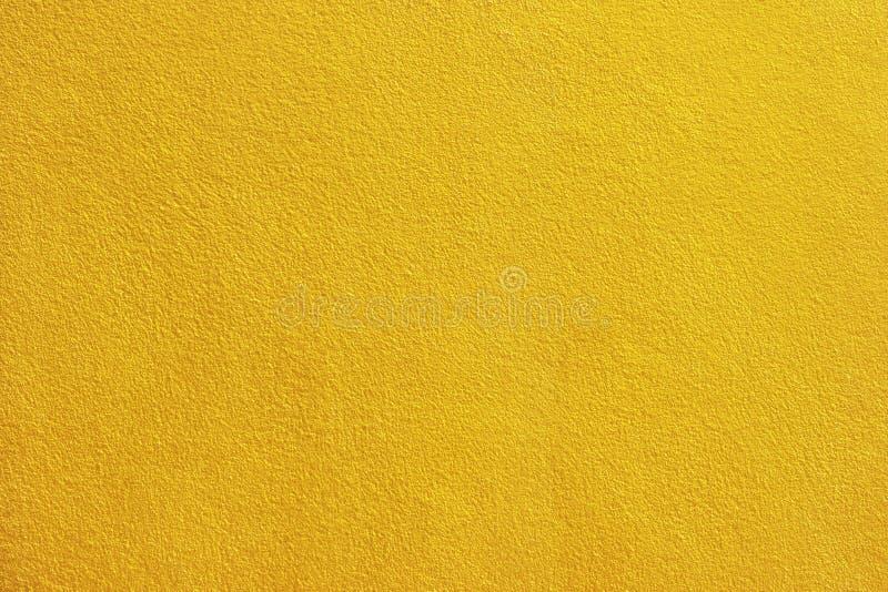 Χρυσό υπόβαθρο τοίχων τσιμέντου χρωμάτων στοκ φωτογραφίες με δικαίωμα ελεύθερης χρήσης