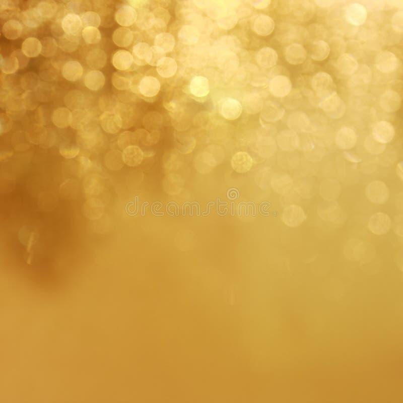 Χρυσό υπόβαθρο φω'των στοκ φωτογραφίες