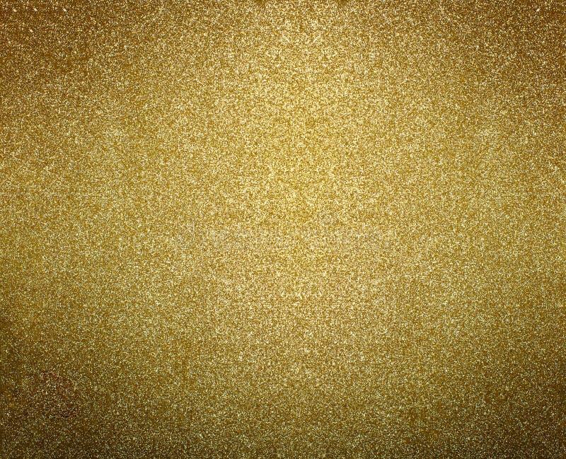 Χρυσό υπόβαθρο Χρυσός ακτινοβολήστε ή λαμπυρίστε σύσταση στοκ φωτογραφίες