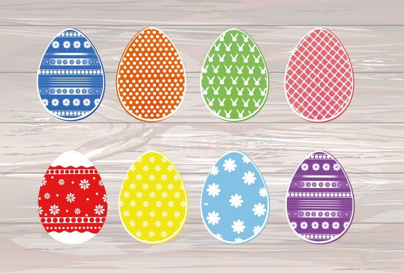 Χρωματισμένα Πάσχα αυγά με ένα σχέδιο Ευχετήρια κάρτα για το holid απεικόνιση αποθεμάτων