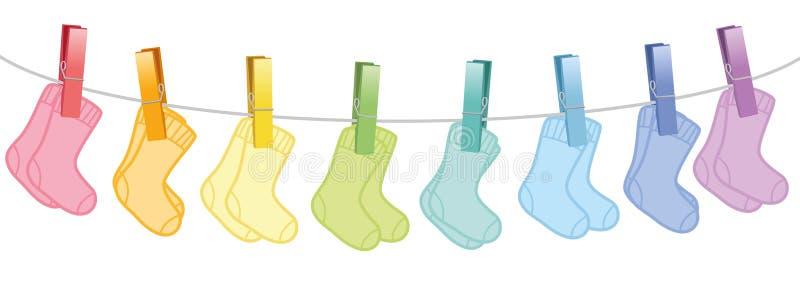 Χρωματισμένη γραμμή ενδυμάτων ζευγαριών μωρών κάλτσες ελεύθερη απεικόνιση δικαιώματος
