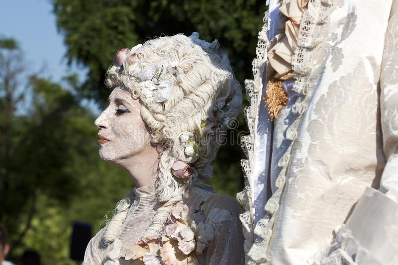 Χρωματισμένη πρόσωπο γυναίκα στοκ φωτογραφίες με δικαίωμα ελεύθερης χρήσης