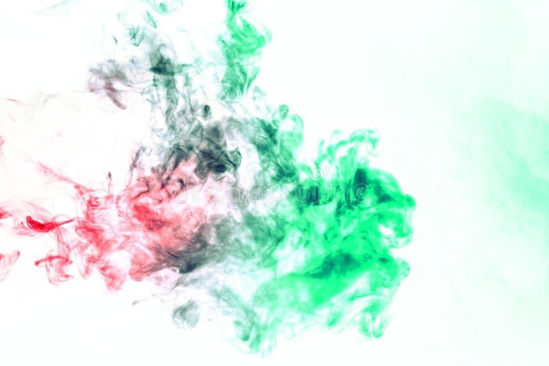 Χρωματισμένο υπόβαθρο με το τύλιγμα των σύννεφων καπνού από τα σχέδια των διαφορετικών μορφών κόκκινων, πράσινων χρωμάτων με τις  στοκ φωτογραφία με δικαίωμα ελεύθερης χρήσης