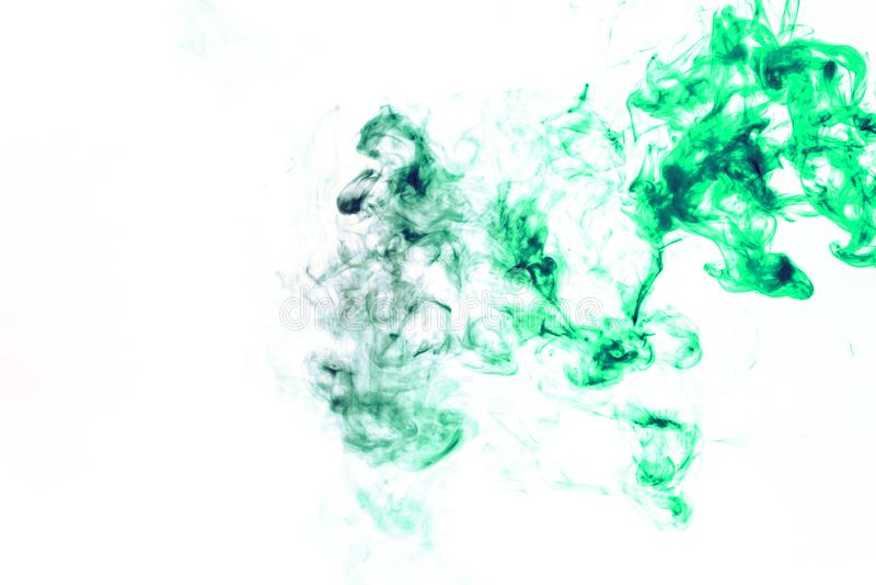 Χρωματισμένο υπόβαθρο με το τύλιγμα των σύννεφων καπνού από τα σχέδια των διαφορετικών μορφών κόκκινων, πράσινων χρωμάτων με τις  στοκ εικόνα με δικαίωμα ελεύθερης χρήσης