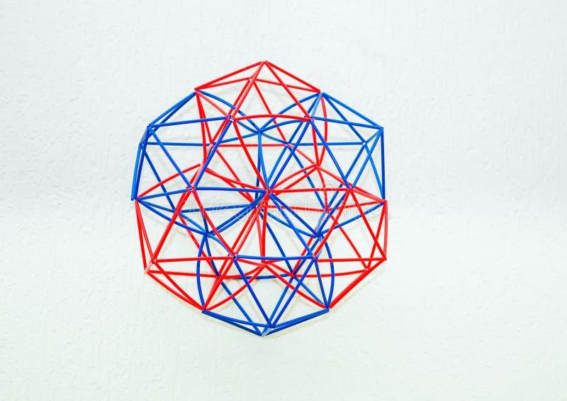 Χρωματισμένο χειροποίητο διαστατικό πρότυπο του γεωμετρικού στερεού στοκ εικόνα