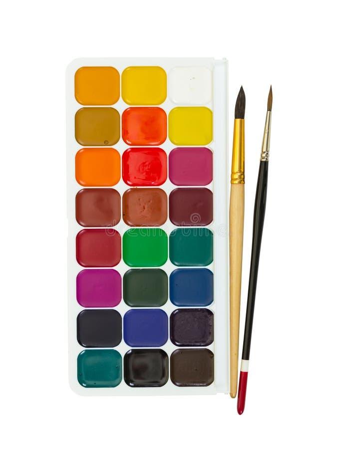Χρώματα watercolor παιδιών ` s και δύο βούρτσες στοκ εικόνα με δικαίωμα ελεύθερης χρήσης