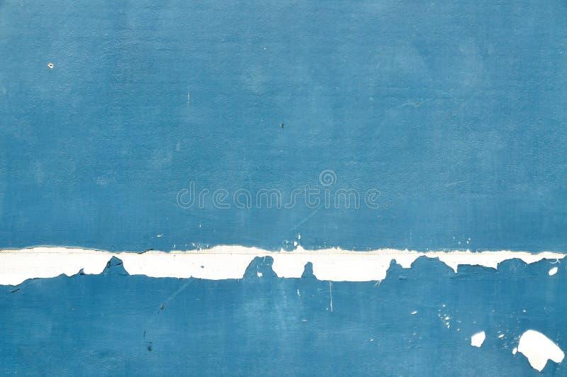 Χρώμα αποφλοίωσης στην άνευ ραφής σύσταση τοίχων. Σχέδιο του αγροτικού μπλε γ στοκ φωτογραφία