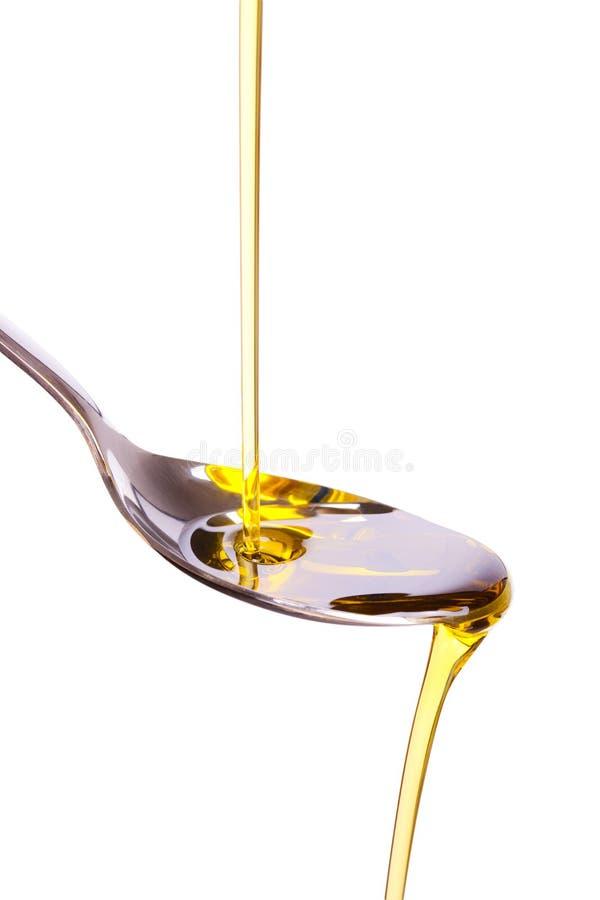 χυμένο ελιά κουτάλι πετρ&ep στοκ εικόνα με δικαίωμα ελεύθερης χρήσης