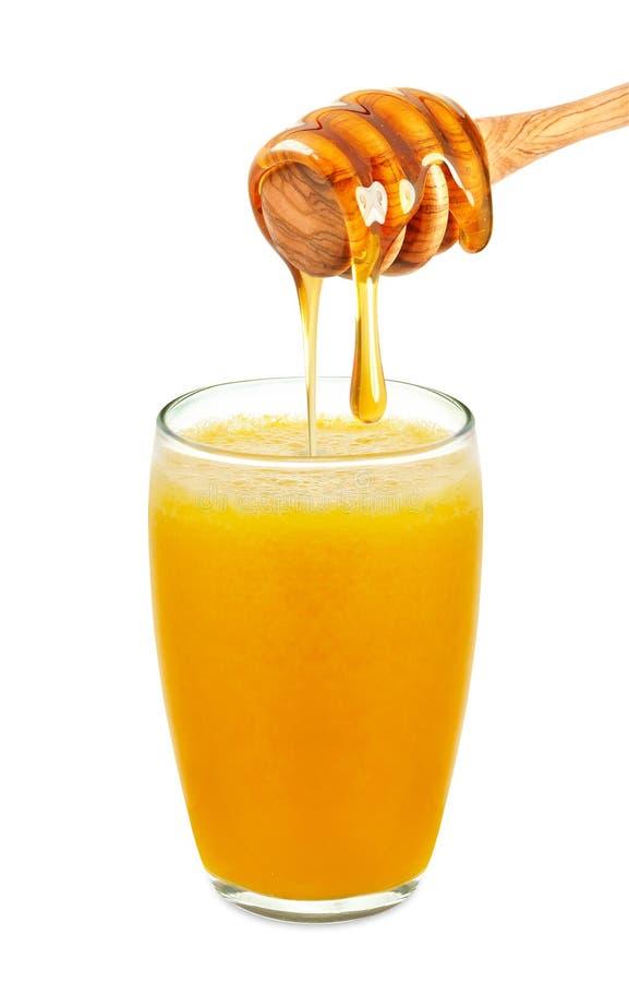 Χυμός από πορτοκάλι με το μέλι στοκ εικόνα με δικαίωμα ελεύθερης χρήσης