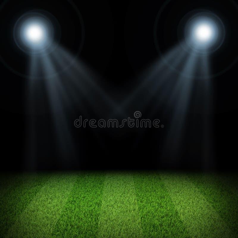 Χώρος ποδοσφαίρου νύχτας που φωτίζεται από τα επίκεντρα στοκ φωτογραφίες