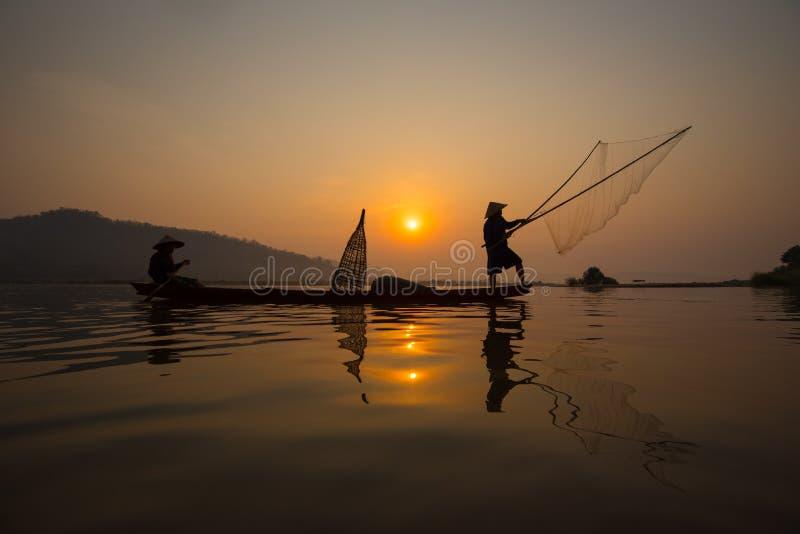 Ψαράς ηλιοβασιλέματος στοκ φωτογραφίες