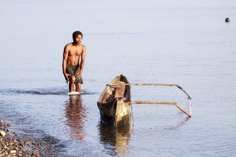 Ψαράς σε μια βάρκα στοκ εικόνες