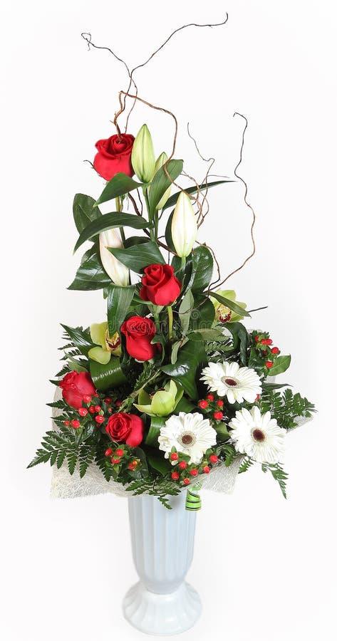 Ψηλά λουλούδια πλαστικό vase. στοκ εικόνες