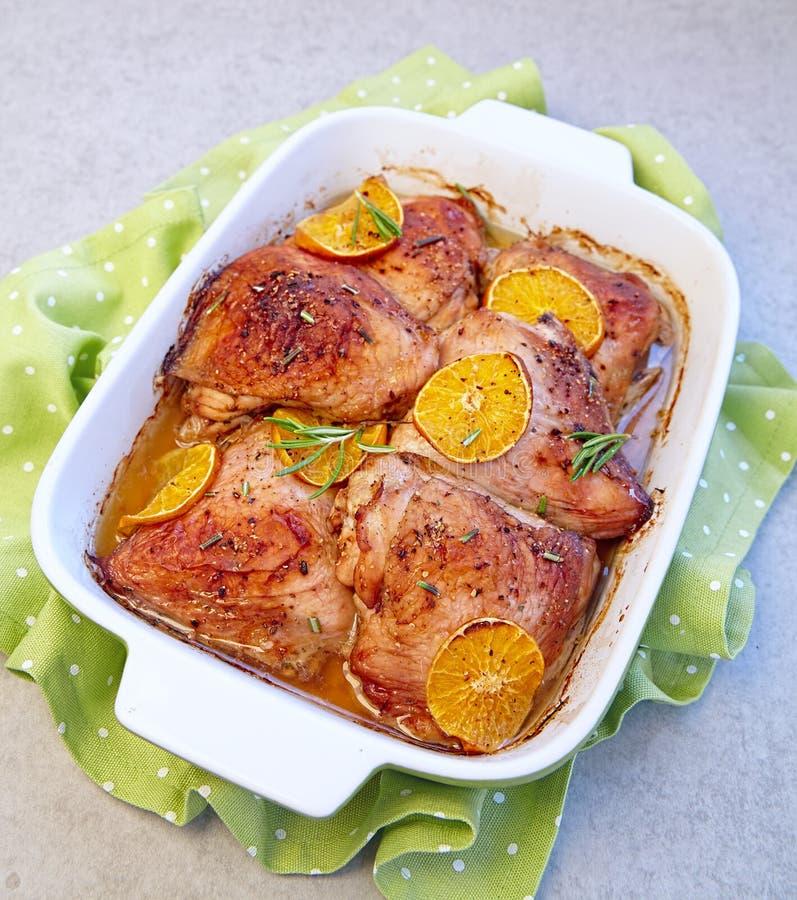 Ψημένα πορτοκαλιά πόδια κοτόπουλου κλημεντινών στοκ εικόνες