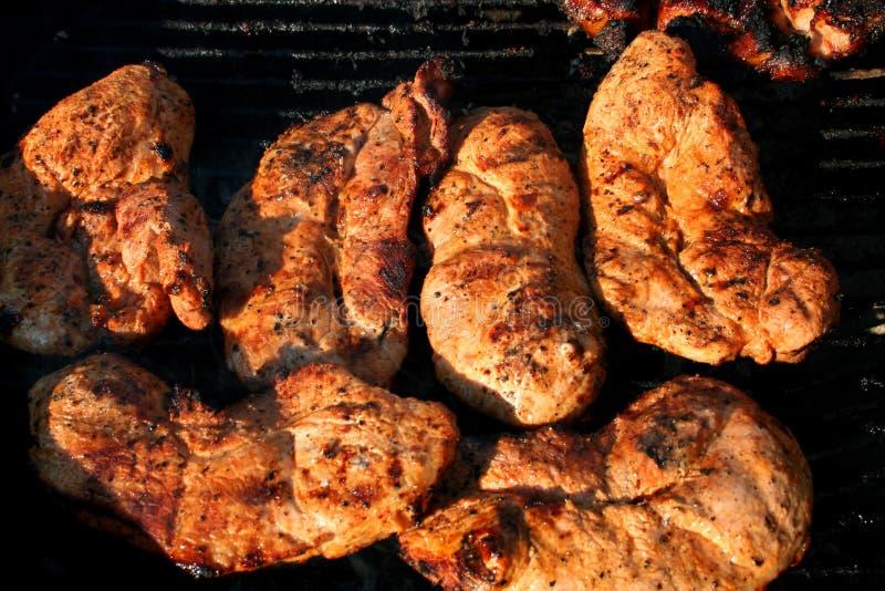 Ψημένες στη σχάρα μπριζόλες κόντρων φιλέτο χοιρινού κρέατος στοκ εικόνα