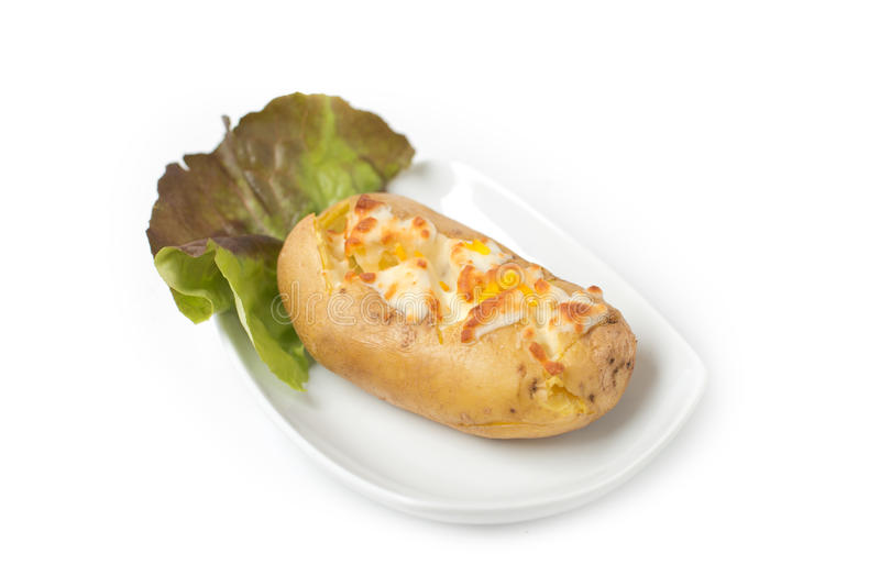 Ψημένη πατάτα με το ζαμπόν και το ξυμένο τυρί στοκ εικόνες