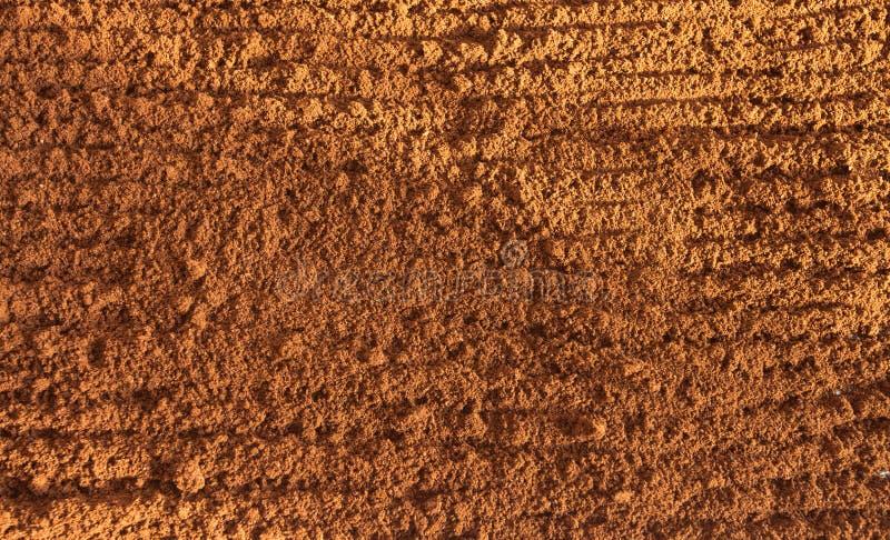 Ψημένος κομματιασμένος καφές ως υπόβαθρο στοκ εικόνα