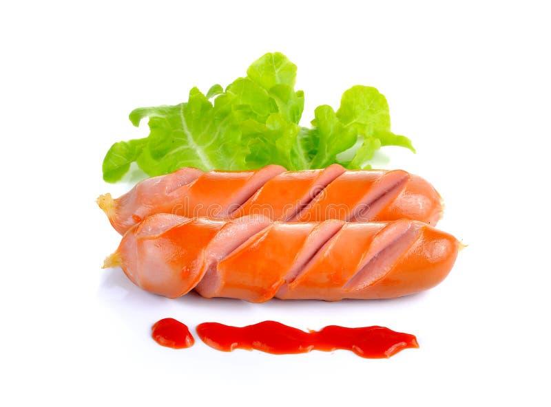 Ψημένο στη σχάρα λουκάνικο με τη σάλτσα ντοματών στοκ φωτογραφία