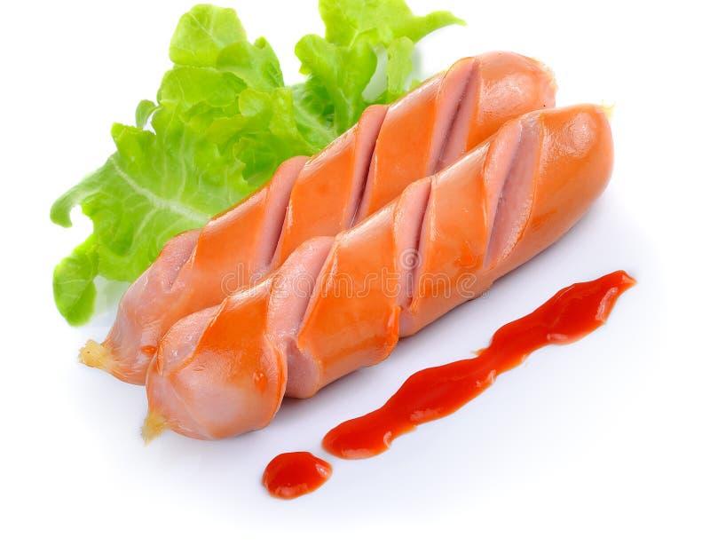 Ψημένο στη σχάρα λουκάνικο με τη σάλτσα ντοματών στοκ φωτογραφία με δικαίωμα ελεύθερης χρήσης