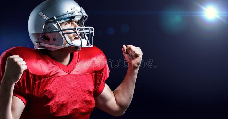 Ψηφιακά παραγμένη εικόνα του φορέα αμερικανικού ποδοσφαίρου ενθαρρυντική με τη σφιγγμένη πυγμή στοκ φωτογραφία με δικαίωμα ελεύθερης χρήσης