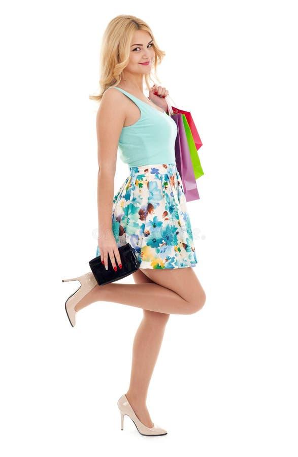 Ψωνίζοντας κορίτσι στο λευκό στοκ εικόνα με δικαίωμα ελεύθερης χρήσης