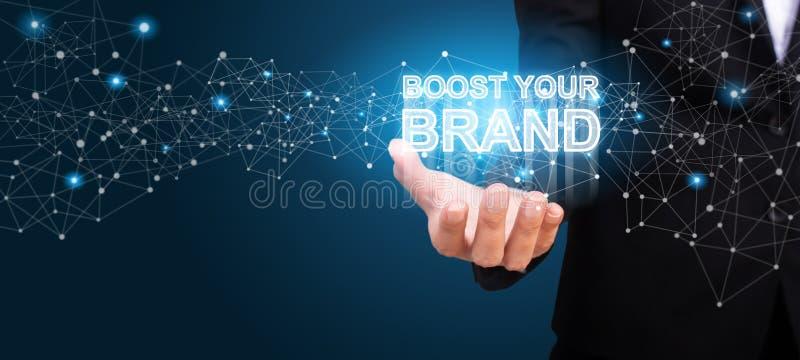 Ωθήστε το εμπορικό σήμα σας στο χέρι της επιχείρησης Ωθήστε το conce εμπορικών σημάτων σας στοκ φωτογραφία με δικαίωμα ελεύθερης χρήσης
