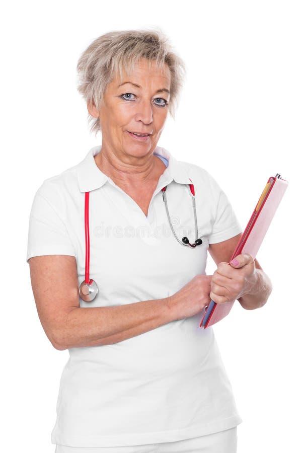 Ωριμασμένος θηλυκός γιατρός, απομονωμένο υπόβαθρο στοκ εικόνα