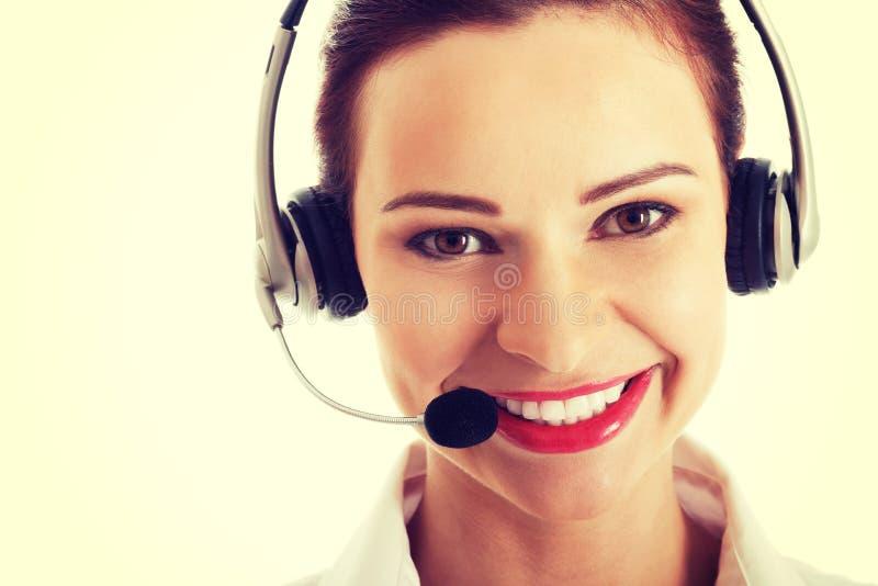 Όμορφα μικρόφωνο και ακουστικά γυναικών στοκ φωτογραφία