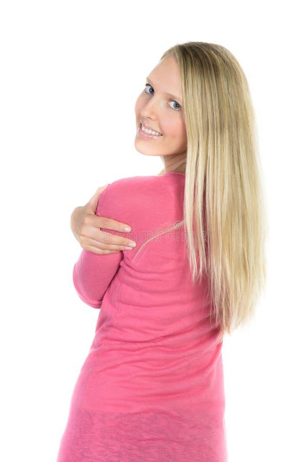 όμορφα χαμόγελα γυναικών που φαίνονται throuhg η πλάτη στοκ φωτογραφίες με δικαίωμα ελεύθερης χρήσης