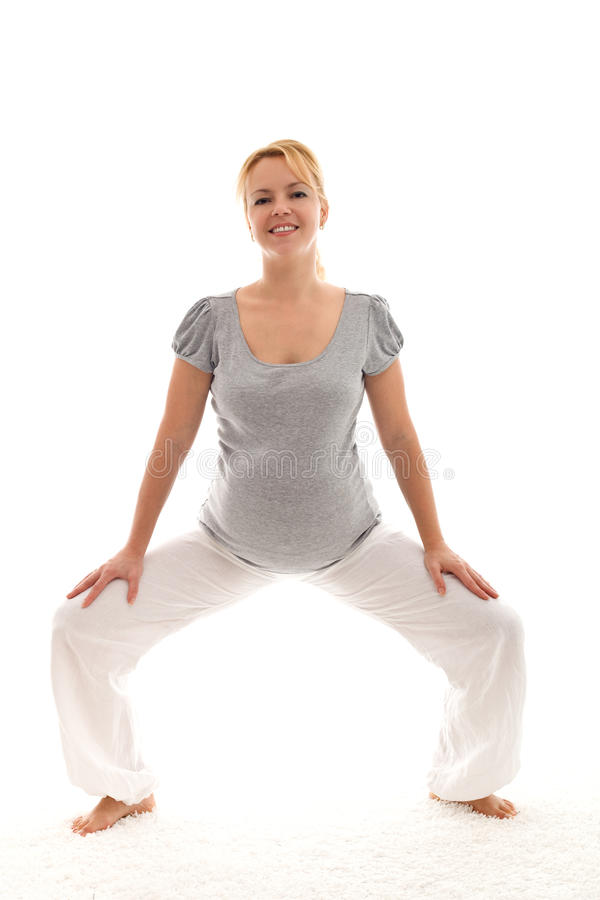 όμορφη ασκώντας έγκυος γ&ups στοκ εικόνα