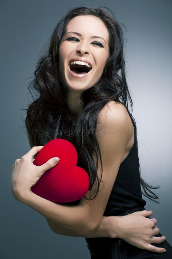 όμορφη γυναίκα βαλεντίνων ημέρας s χαμογελώντας στοκ φωτογραφία