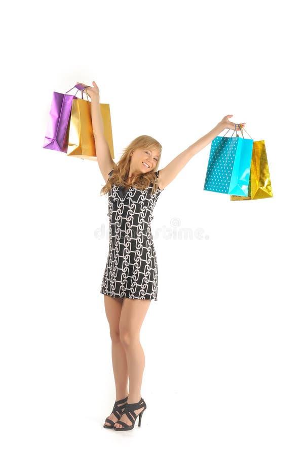 Όμορφη γυναίκα με πολλές τσάντες αγορών. απομονωμένος στο λευκό στοκ εικόνες