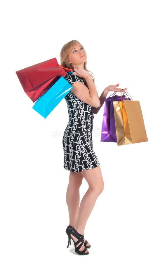 Όμορφη γυναίκα με πολλές τσάντες αγορών. απομονωμένος στο λευκό στοκ φωτογραφία