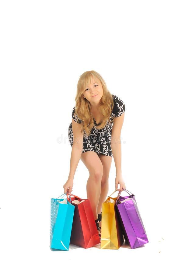 Όμορφη γυναίκα με πολλές τσάντες αγορών. στο λευκό στοκ φωτογραφία με δικαίωμα ελεύθερης χρήσης