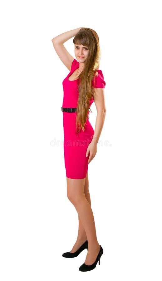 Όμορφη γυναίκα με τα μακριά τριχώματα στο κόκκινο φόρεμα στοκ φωτογραφία με δικαίωμα ελεύθερης χρήσης