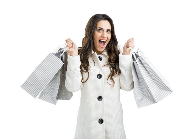 Όμορφη γυναίκα με τις τσάντες αγορών στοκ εικόνες