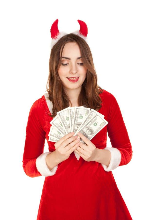 Όμορφη γυναίκα με το κέρατο που κρατά πολλά χρήματα στοκ εικόνες