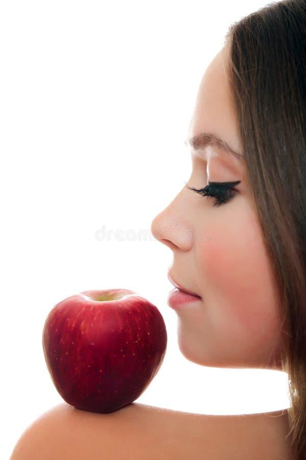 Όμορφη γυναίκα με το κόκκινο μήλο στοκ εικόνες με δικαίωμα ελεύθερης χρήσης