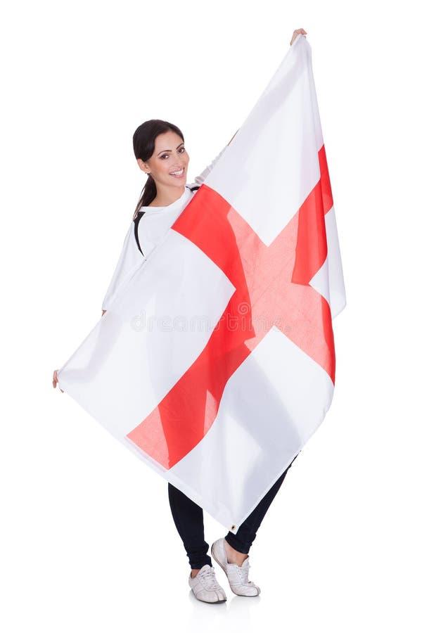 Όμορφη γυναίκα που κρατά μια αγγλική σημαία στοκ φωτογραφία με δικαίωμα ελεύθερης χρήσης