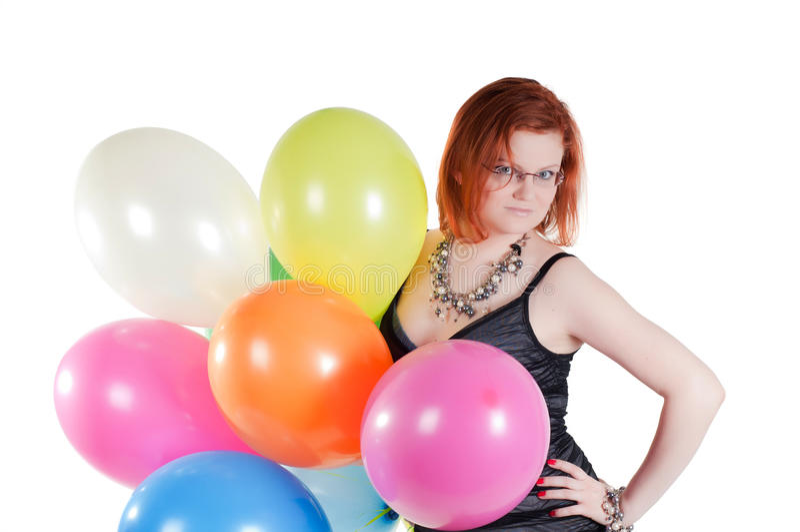 Όμορφη γυναίκα που κρατά τα πολύχρωμα μπαλόνια αέρα στοκ φωτογραφία