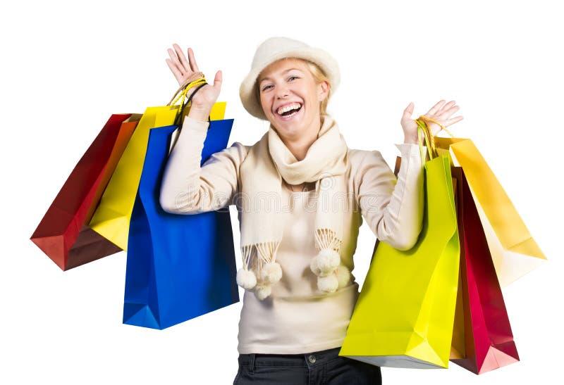 Όμορφη γυναίκα που φέρνει πολλές τσάντες αγορών στοκ φωτογραφία με δικαίωμα ελεύθερης χρήσης