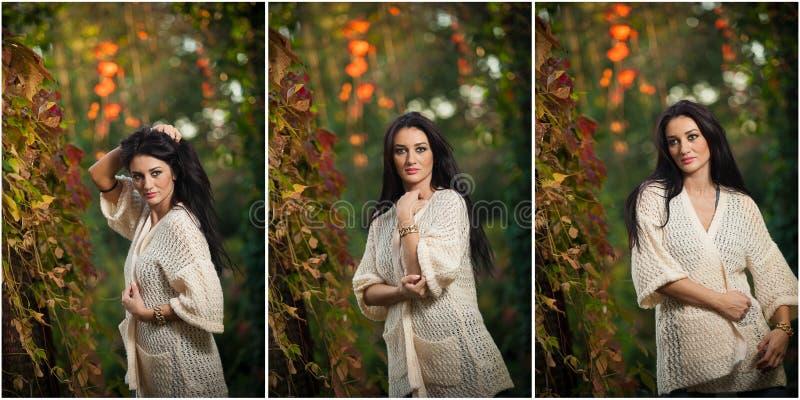 Όμορφη γυναίκα στην άσπρη τοποθέτηση στο φθινοπωρινό πάρκο Νέος χρόνος εξόδων γυναικών brunette το φθινόπωρο κοντά σε ένα δέντρο  στοκ εικόνα