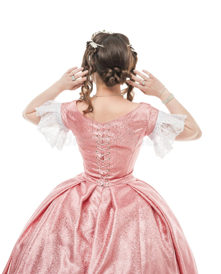 Όμορφη γυναίκα στο παλαιό ιστορικό μεσαιωνικό φόρεμα Η πλάτη θέτει στοκ εικόνα με δικαίωμα ελεύθερης χρήσης