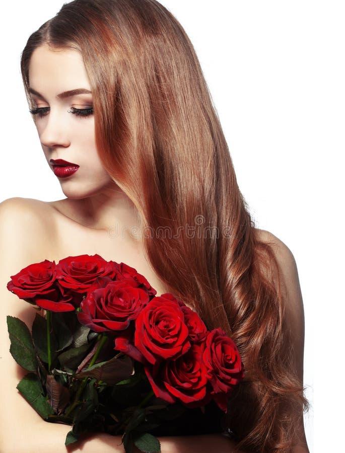 Όμορφη δέσμη εκμετάλλευσης κοριτσιών των τριαντάφυλλων στοκ εικόνα με δικαίωμα ελεύθερης χρήσης