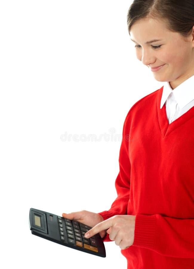 Όμορφη μαθήτρια που χρησιμοποιεί τον υπολογιστή στοκ εικόνες