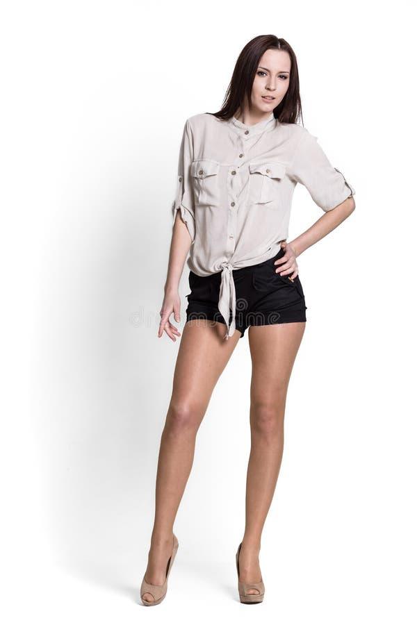 όμορφη μπεζ γυναίκα μπλουζών στοκ εικόνα με δικαίωμα ελεύθερης χρήσης