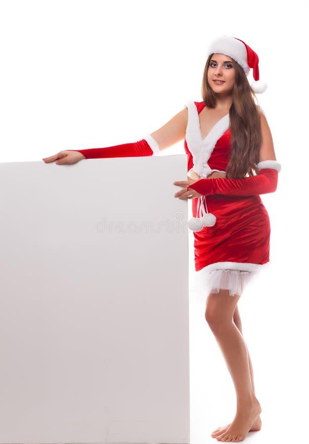 Όμορφη νέα γυναίκα Χριστουγέννων στο καπέλο santa που κρατά τον κενό κάπρο στοκ φωτογραφίες με δικαίωμα ελεύθερης χρήσης